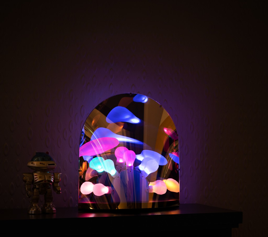 Space-table-lamp-on-cabinet-in-dark-full-color-light