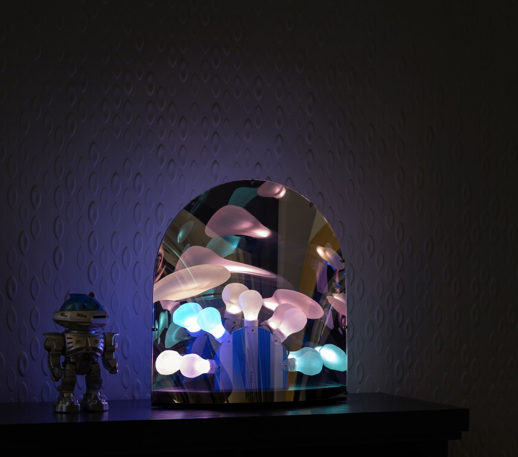 Space-table-lamp-on-cabinet-in-dark-pastel-light