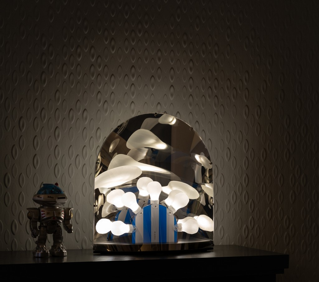 Space-table-lamp-on-cabinet-in-dark-white-light